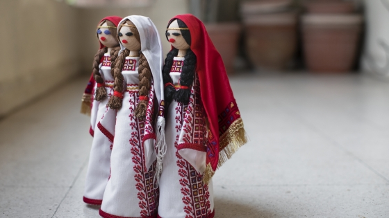 1)	Palestinian dolls in traditional festive dress made at the Ein El-Hilweh camp where 64 women are trained in this technique in order to preserve the Palestinian embroidery and heritage. Beirut, Lebanon, 2019, (c) Photo: Mashid Mohadjerin